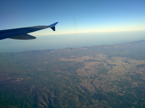 image from airplane window at height looking over Nicosia
